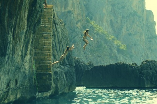 Girls-jumping-from-a-rock-into-the-sea-Sa-Calobra-Mallorca-Spain-640x426
