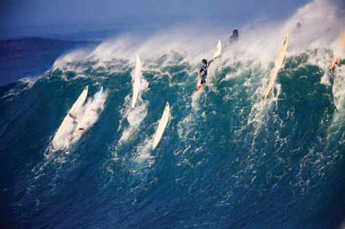 Surfers at Waimea Bay in Hawaii