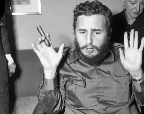 17 Let's see a show of hands! Fidel Castro talks to reporters at the Statler Hilton during his visit