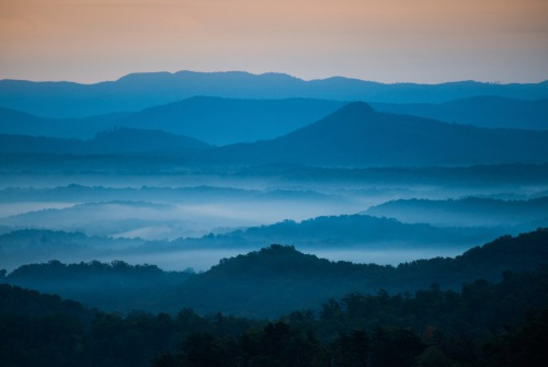 The mountains on the Blue Ridge Parkway welcome the morning with light and mist. Fog is forming in the valley as the sun comes up lighting up the day. Enjoye!
