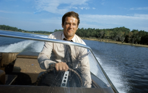 KINGSTON, JAMAICA - MARCH 1:  Roger Moore poses on location for the filming of James Bond film 'Live And Let Die' on March 1, 1973 in Kingston, Jamaica (Photo by Anwar Hussein/Getty Images) *** Local Caption *** Roger Moore