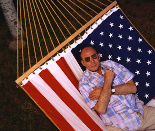 Hunter S. Thompson on American Flag Hammock --- Image by © Louie Psihoyos/Corbis
